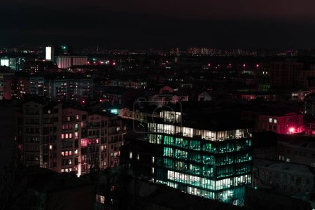 night cityscape with colorful illuminated buildings