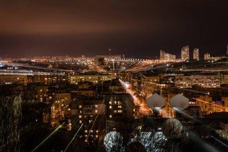 night cityscape with defocused bright illumination