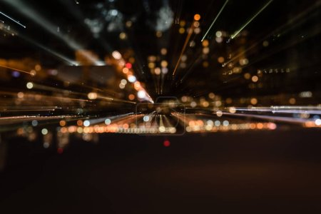 Photo for Cityscape with blurred bright illumination from windows at night - Royalty Free Image