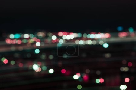 blurred colorful bokeh lights at night