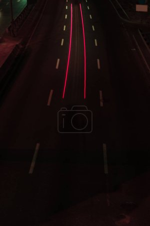 long exposure of road and bright lights at night