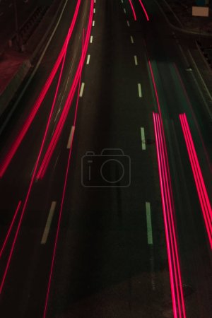 long exposure of road and red lights at night