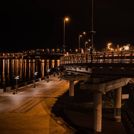 Photo for Illuminated street and bridge with bright lights at night - Royalty Free Image
