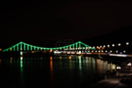 Photo for Illuminated bridge with blurred bokeh lights at night - Royalty Free Image