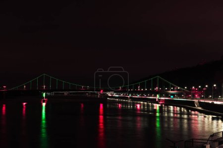 illuminated bridge with colorful lights at night