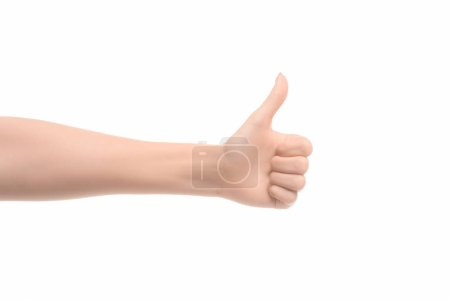 partial view of woman showing thumb up sign isolated on white