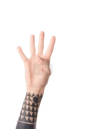partial view of tattooed man showing number 4 in sign language isolated on white