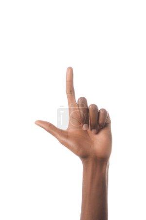 Photo pour Vue partielle de l'homme américain montrant la lettre L en langage sourd et muet, isolé sur blanc - image libre de droit