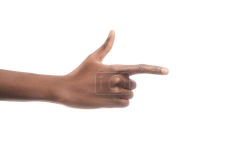 Photo pour Vue recadrée de l'homme afro-américain pointant à droite avec le doigt isolé sur blanc - image libre de droit