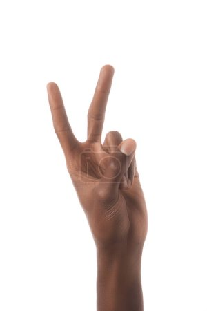 partial view of african american man showing number 2 in sign language isolated on white