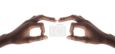 cropped view of african american man gesturing with fingers and forming binoculars isolated on white background