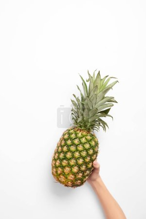 Photo for Cropped view of woman holding organic pineapple in hand on white background - Royalty Free Image