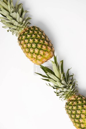 Photo for Top view of delicious yellow pineapples on white background - Royalty Free Image