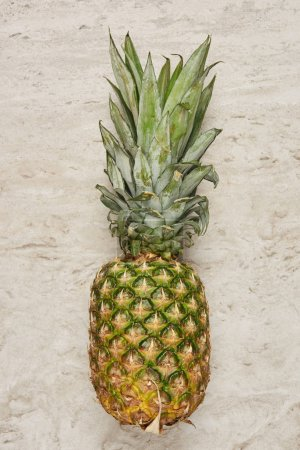 top view of ripe and tasty pineapple on marble background