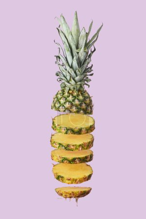 Photo for Sliced sweet organic pineapple isolated on purple - Royalty Free Image