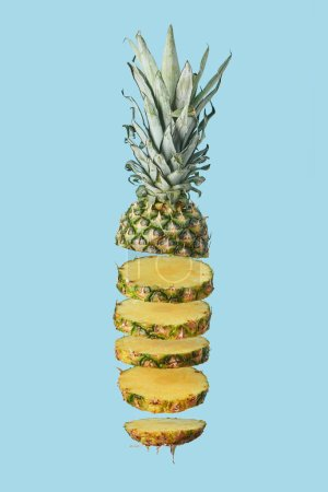 Photo for Sliced ripe organic pineapple isolated on blue - Royalty Free Image