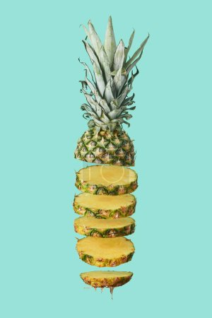 Photo for Sliced sweet organic pineapple isolated on turquoise - Royalty Free Image