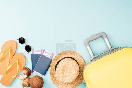 Photo for Top view of straw hat, coconut, flip flops, seashells, sunglasses, passports, air tickets and travel bag on blue background - Royalty Free Image