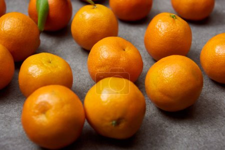 Photo for Selective focus of organic tangerines on grey table - Royalty Free Image