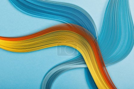 Photo for Multicolored bright abstract lines on blue background - Royalty Free Image