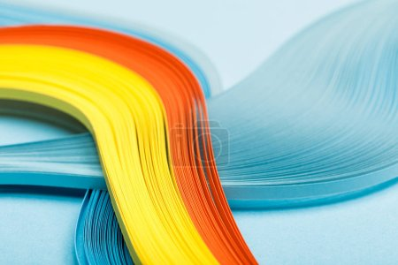 close up of yellow, orange and blue abstract lines on blue background