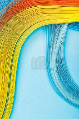 top view of yellow, orange and blue lines on blue background