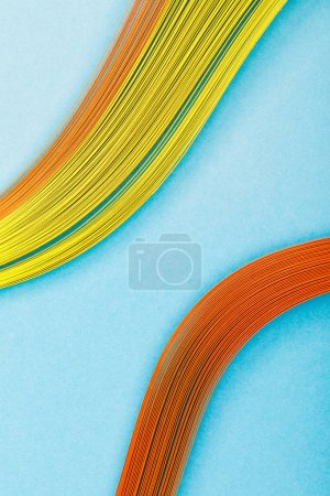 close up of multicolored abstract lines on blue background