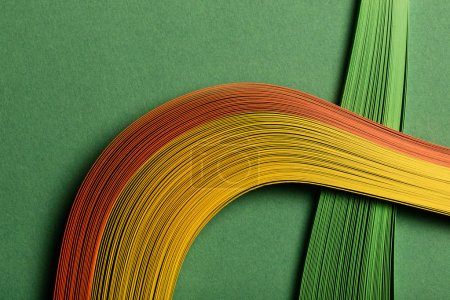 Photo for Close up of multicolored abstract lines on green background - Royalty Free Image