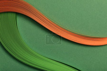 Photo for Close up of green and orange abstract lines on green background - Royalty Free Image