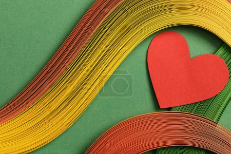 Photo for Top view of multicolored abstract lines on green background with red heart sign - Royalty Free Image