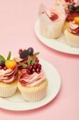 """Постер, картина, фотообои """"two plates with sweet cakes on pink surface"""""""