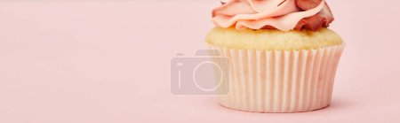 Photo for Panoramic shot of sweet cupcake with cream on pink surface - Royalty Free Image