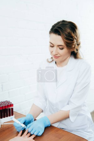 Photo for Cropped view of donor and doctor obtaining blood sample - Royalty Free Image