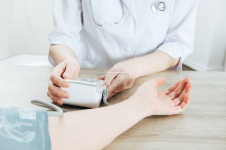 cropped view of patient and doctor measuring blood pressure