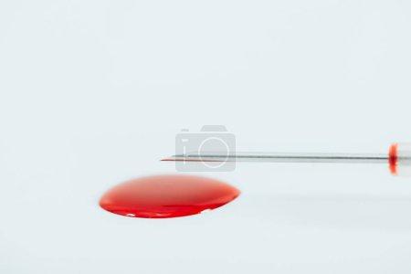 Photo for Syringe needle and blood stain isolated on white - Royalty Free Image