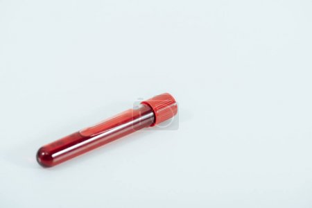 Photo for Test tube with blood sample on white surface - Royalty Free Image