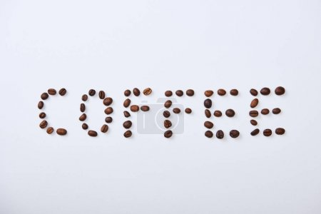Photo for Top view of coffee lettering made of coffee beans on white background - Royalty Free Image