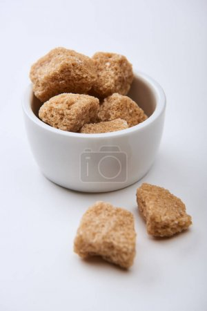 Photo for Close up view of granulated brown sugar in bowl on white background - Royalty Free Image