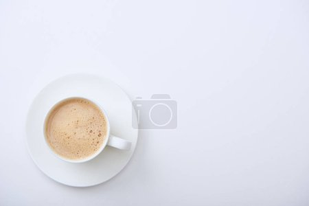Photo for Top view of delicious coffee with foam on white background with copy space - Royalty Free Image