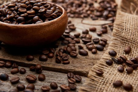 Photo for Close up view of coffee beans on bowl on wooden background - Royalty Free Image