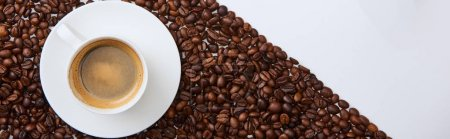 Photo for Panoramic shot of of tasty coffee in cup on saucer near roasted beans - Royalty Free Image
