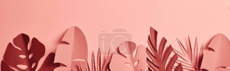 Photo for Top view of paper cut palm leaves on pink background, panoramic shot - Royalty Free Image