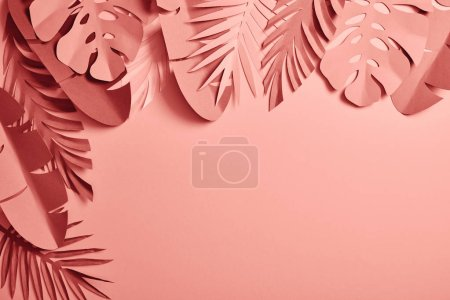 Photo for Top view of exotic paper cut palm leaves on pink background with copy space - Royalty Free Image