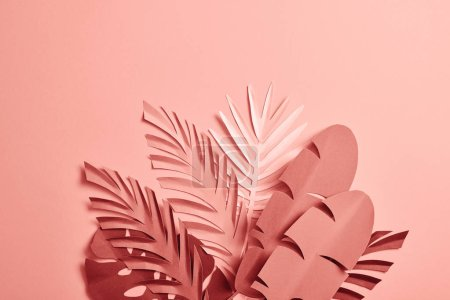 Photo for Bunch of paper cut palm leaves on pink background - Royalty Free Image