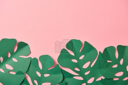 Photo for Top view of green palm leaves on pink background with copy space - Royalty Free Image