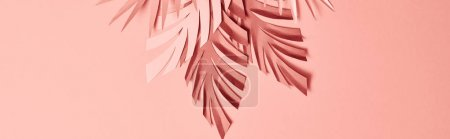 Photo for Top view of colorful paper cut palm leaves on pink background, panoramic shot - Royalty Free Image