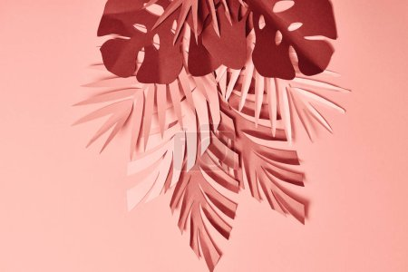 Photo for Bunch of colorful paper cut palm leaves on pink background - Royalty Free Image