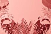 """Постер, картина, фотообои """"верхний вид розовой экзотической бумаги вырезать пальмовые листья и фламинго на розовом фоне с копией пространства"""""""