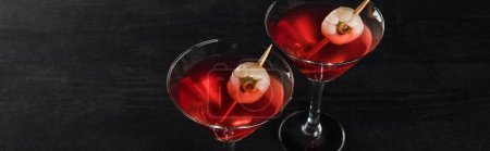 Photo for Panoramic shot of red decorated Halloween cocktails on black background - Royalty Free Image