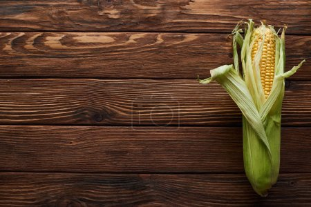 Photo for Top view of fresh corn on wooden surface with copy space - Royalty Free Image